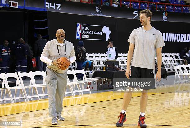 Head Coach Lionel Hollins of Team World smiles with Pau Gasol of Team World during practice for the NBA Africa Game 2015 as part of Basketball...