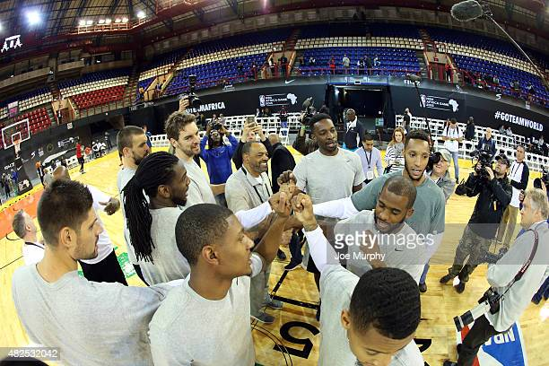 Head Coach Lionel Hollins smiles in a huddle with Team World during practice for the NBA Africa Game 2015 as part of Basketball Without Borders on...