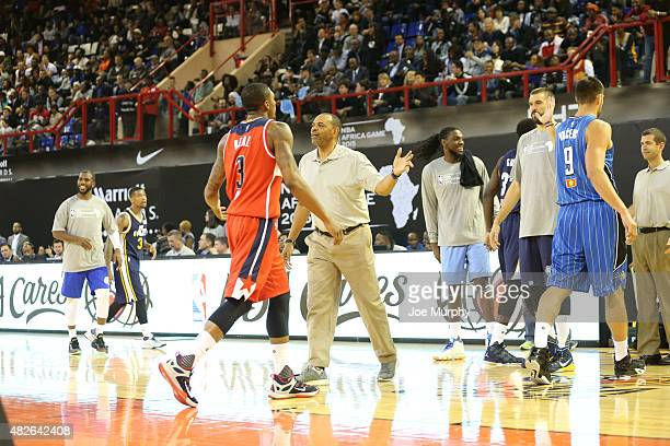 Head Coach Lionel Hollins taks to Bradley Beal of Team World against Team Africa during the NBA Africa Game 2015 as part of Basketball Without...