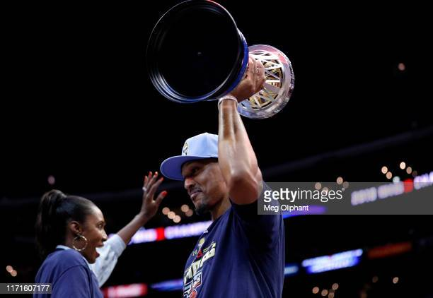 Head coach Lisa Leslie and Jamario Moon of the Triplets celebrate with the trophy after defeating the Killer 3s to win the BIG3 Championship at...