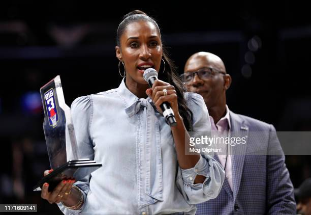 Head coach Lisa Leslie of the Triplets is awarded the Coach of the Year trophy by BIG3 commissioner Clyde Drexler during the BIG3 Championship at...