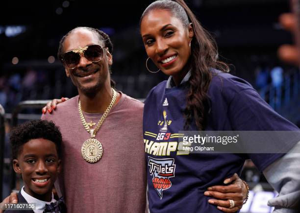 Head coach Lisa Leslie of the Triplets poses with her son and Snopp Dogg after the Triplets defeated the Killer 3s to win the BIG3 Championship at...
