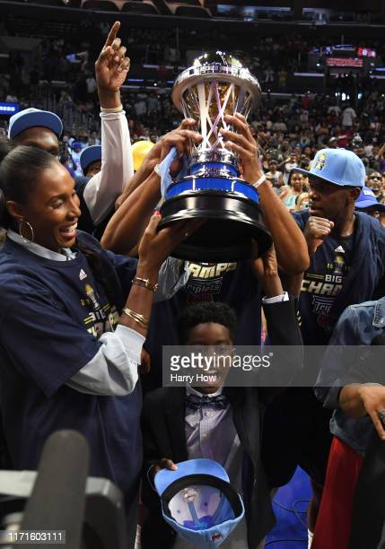 Head coach Lisa Leslie of the Triplets poses with her son and the trophy after her team defeated the Killer 3s to win the BIG3 Championship at...