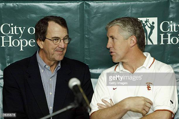 Head coach Lloyd Carr of the University of Michigan and head coach Pete Carroll of USC speak during a visit by the Rose Bowl football teams to City...