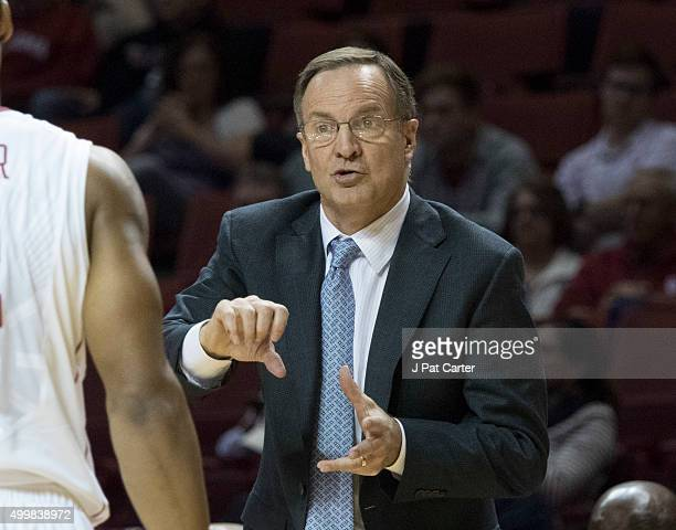Head coach Lon Kruger of the Oklahoma Sooners calls plays against Central Arkansas during the second half of a NCAA college basketball game against...