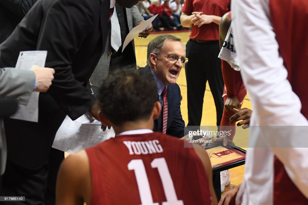 Head coach Lon Kruger of the Oklahoma Sooners instructs his team at a time out during the second half of the game against the Texas Tech Red Raiders on February 13, 2018 at United Supermarket Arena in Lubbock, Texas. Texas Tech defeated Oklahoma 88-78.