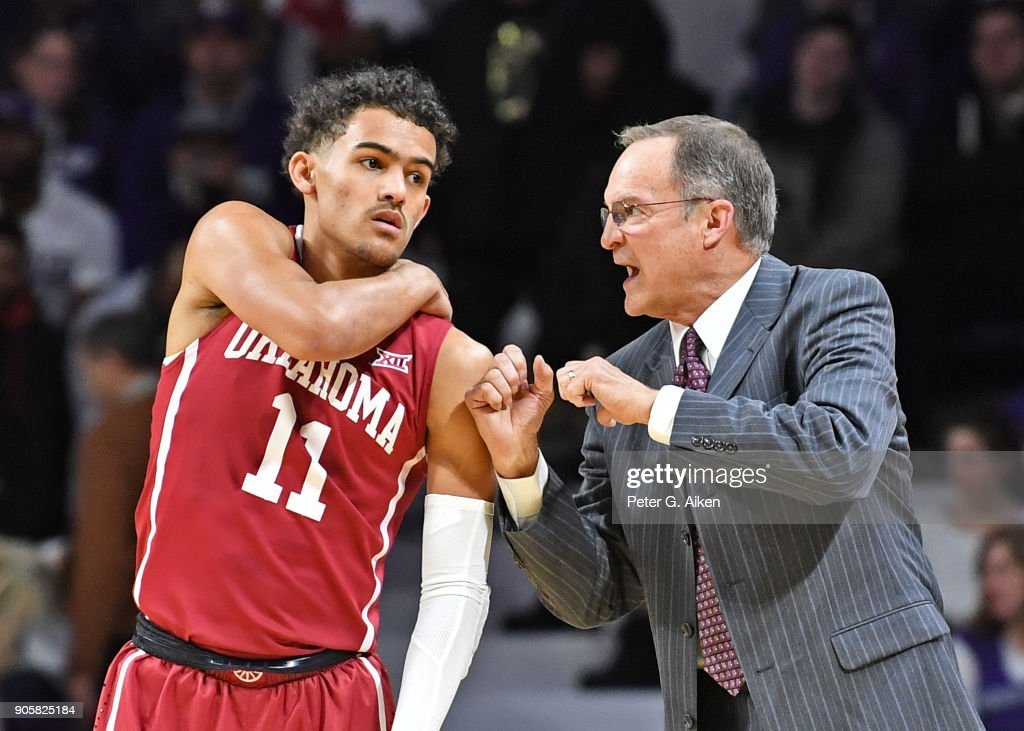 Head coach Lon Kruger (R) of the Oklahoma Sooners instructs Trae Young #11 against the Kansas State Wildcats during the first half on January 16, 2018 at Bramlage Coliseum in Manhattan, Kansas.