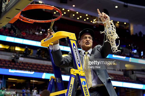 Head coach Lon Kruger of the Oklahoma Sooners smiles after cutting a piece of the net after the Sooners 8068 victory against the Oregon Ducks in the...