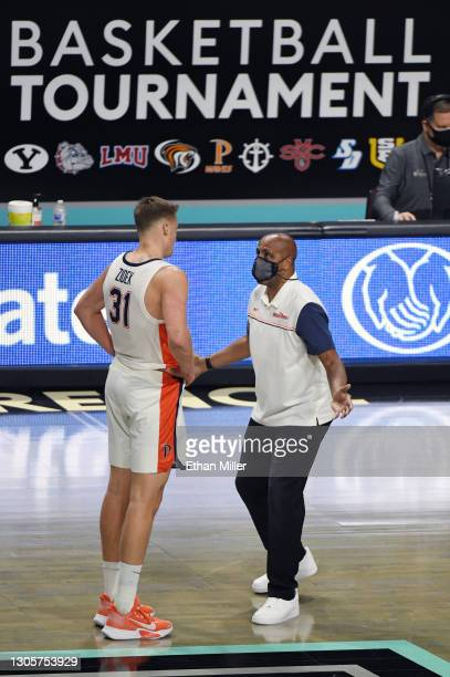 Head coach Lorenzo Romar of the Pepperdine Waves talks to Jan Zidek during a timeout in their game against the Santa Clara Broncos during the West...