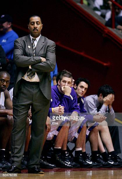 Head coach Lorenzo Romar of the Washington Huskies closes his eyes in the second half of the Huskies' loss to the Louisville Cardinals during the...