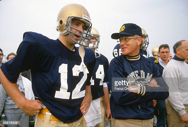 Head Coach Lou Holtz of the Notre Dame Fighting Irish gives instructions to his players during a practice circa 1988 at Notre Dame in South Bend,...