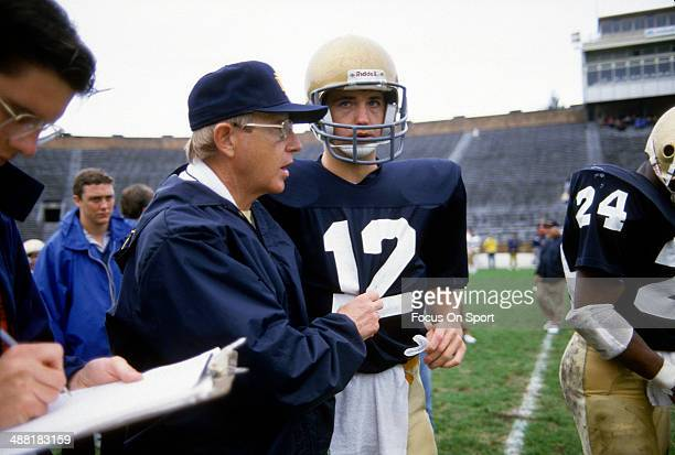 Head Coach Lou Holtz of the Notre Dame Fighting Irish gives instructions to his players during a practice circa 1988 at Notre Dame Stadium in South...