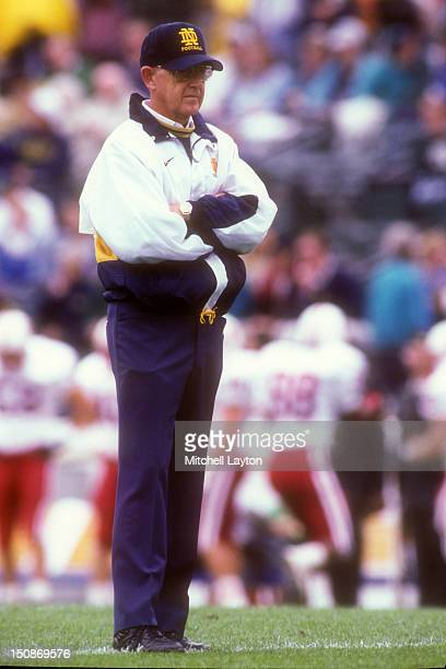 Head coach Lou Holtz of the Notre Dame Fighting Irish looks on before a college football game against the Stanford Cardinal on October 1, 1994 at...
