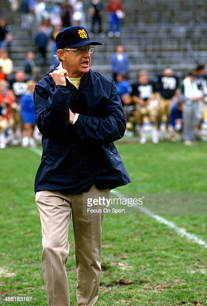 Head Coach Lou Holtz of the Notre Dame Fighting Irish looks on during a practice circa 1988 at Notre Dame Stadium in South Bend, Indiana. Holtz...