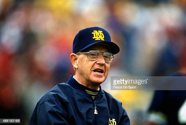 Head Coach Lou Holtz of the Notre Dame Fighting Irish looks on during an NCAA Football game circa 1990. Holtz coached the Notre Dame Fighting Irish...