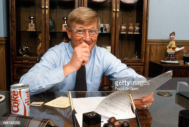 Head Coach Lou Holtz of the Notre Dame Fighting Irish sitting behind his desk smiling in this portrait circa 1986 at Notre Dame University in South...