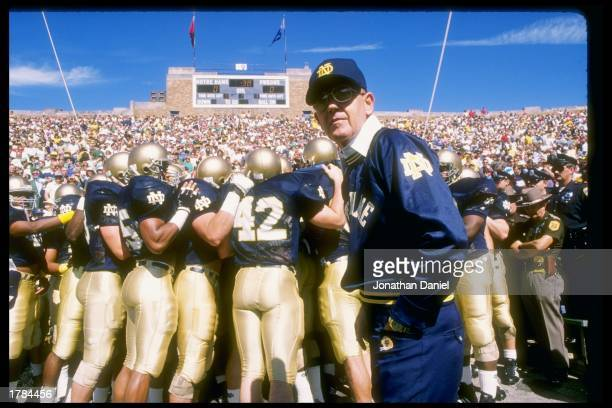 Head coach Lou Holtz of the Notre Dame Fighting Irish stands on the sidelines during the first quarter in the game against the Miami Hurricanes on...