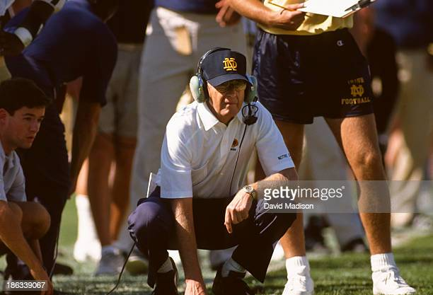Head coach Lou Holtz of the Notre Dame Fighting Irish watches from the sidelines during an NCAA football game against the Stanford Cardinal on...