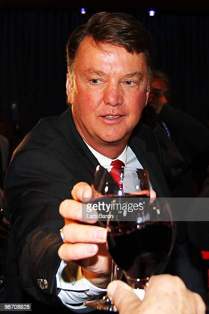Head coach Louis van Gaal drinks a glass of red vine at the Champions League dinner after reaching the final following their 30 victory of the UEFA...