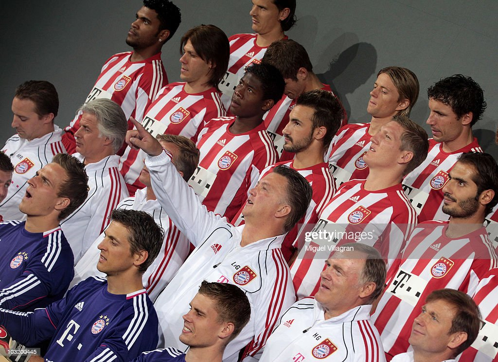 Head coach Louis van Gaal gives instructions while he poses with his team for a group picture during the FC Bayern Muenchen team presentation at Bayern's training ground Saebener Strasse on August 2, 2010 in Munich, Germany.