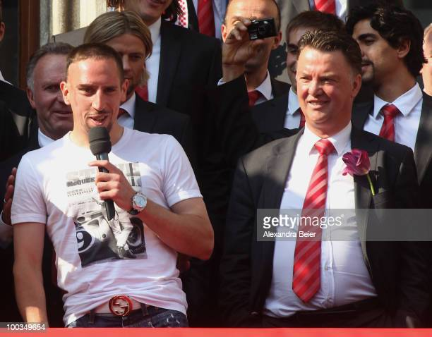 Head coach Louis van Gaal listens to Franck Ribery of Bayern Muenchen during the celebration party of the two titles at the balcony of the town hall...