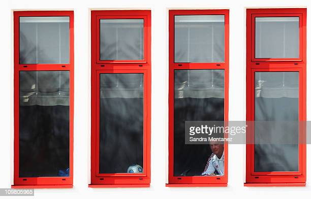 Head coach Louis van Gaal looks out of the window during the FC Bayern Muenchen training session at Bayern's training ground Saebener Strasse on...