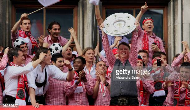 Head coach Louis van Gaal of Bayern Muenchen and his team celebrate their German championship title on the balcony of the town hall on May 9 2010 in...