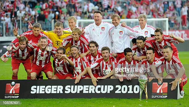 Head coach Louis van Gaal of Bayern Muenchen and his team pose after winning the Supercup match between FC Bayern Muenchen and FC Schalke 04 at...