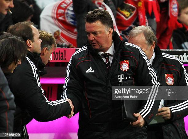 Head coach Louis van Gaal of Bayern Muenchen shakes hands with manager Christian Nerlinger after their team's victory of the Bundesliga match between...