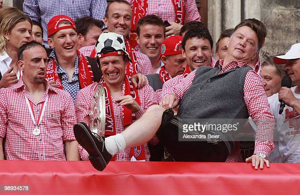 Head coach Louis van Gaal of Bayern Muenchen shows his traditional Bavarian outfit as the team celebrates their German championship title on the...