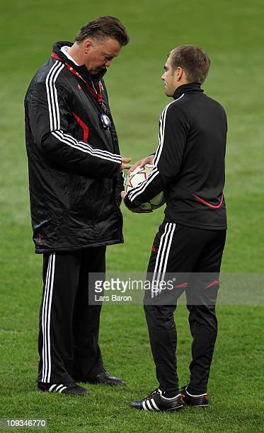 Head coach Louis van Gaal of Bayern Muenchen speaks with Philipp Lahm during a training session the day before the UEFA Champions League round of 16...