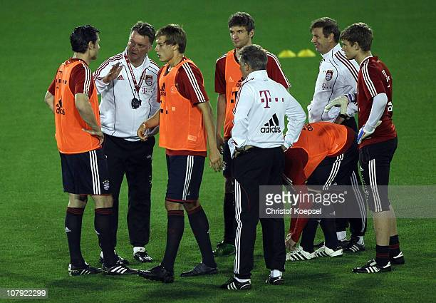 Head coach Louis van Gaal of Bayern speaks to Mark van Bommel of Bayern during the FC Bayern Muenchen training session at Aspire Academy for Sports...