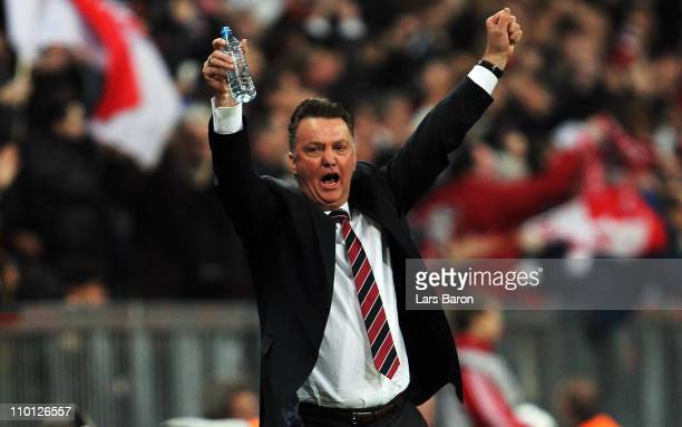 Head coach Louis van Gaal of Muenchen celebrates after Thomas Mueller scored his teams second goal during the UEFA Champions League round of 16...