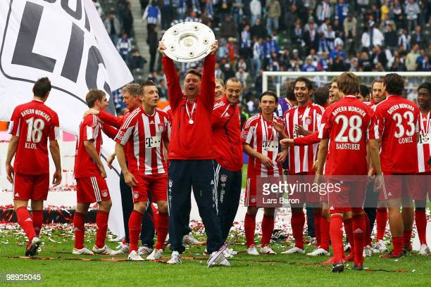 Head coach Louis van Gaal of Muenchen celebrates with the trophy after the Bundesliga match between Hertha BSC Berlin and FC Bayern Muenchen at...