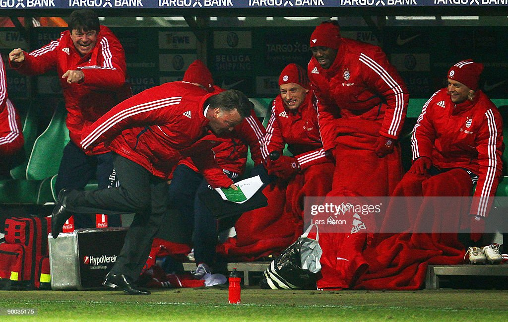 Head coach Louis van Gaal of Muenchen tumbles while running away from Arjen Robben who scored the winning goal during the Bundesliga match between SV Werder Bremen and FC Bayern Muenchen at Weser Stadium on January 23, 2010 in Bremen, Germany.