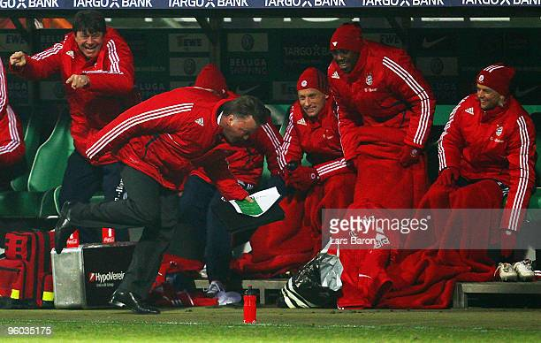 Head coach Louis van Gaal of Muenchen tumbles while running away from Arjen Robben who scored the winning goal during the Bundesliga match between SV...