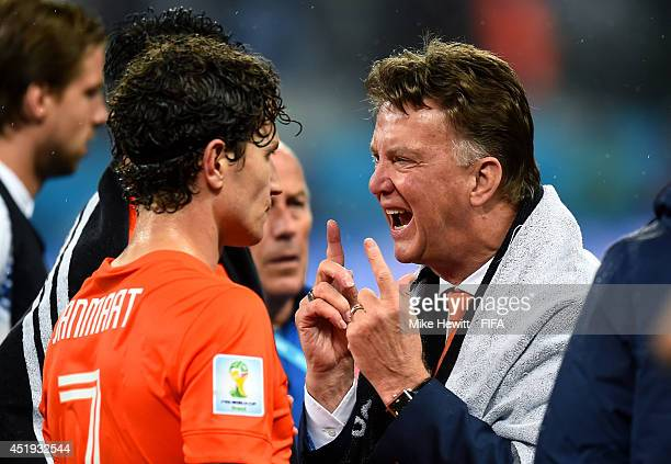 Head coach Louis van Gaal of the Netherlands instructs to Daryl Janmaat before the extra time during the 2014 FIFA World Cup Brazil Semi Final match...