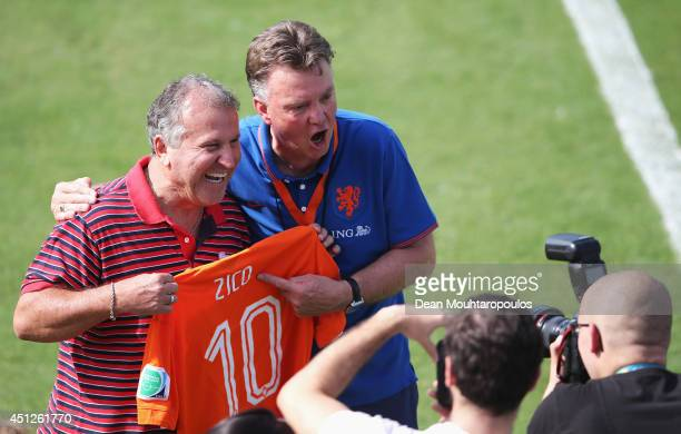 Head Coach Louis van Gaal poses with Brazilian football Legend Zico as he is presented a signed Dutch shirt during the Netherlands training session...