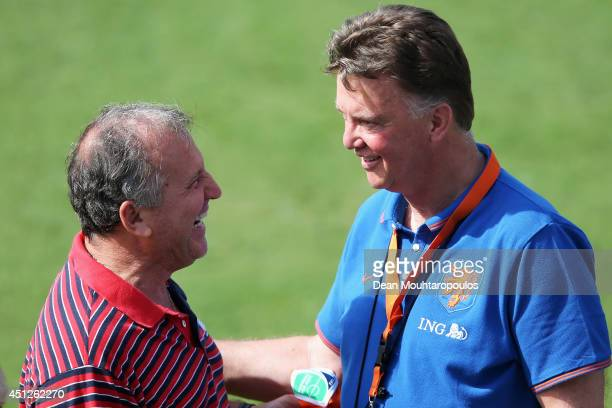 Head Coach Louis van Gaal speaks with Brazilian football Legend Zico during the Netherlands training session at the 2014 FIFA World Cup Brazil held...