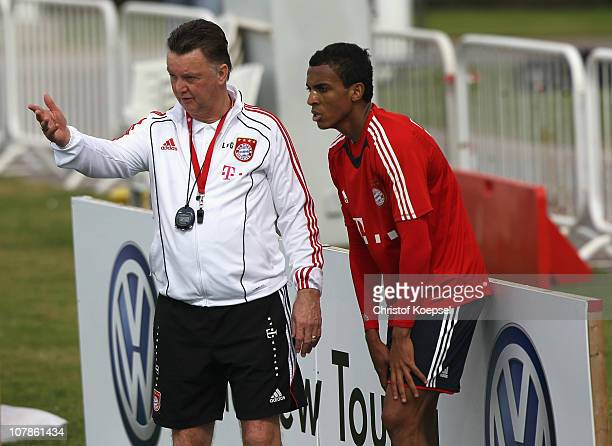 Head coach Louis van Gaal talks to Luiz Gustavo during the FC Bayern Muenchen training session at Aspire Academy for Sports Excellence training...