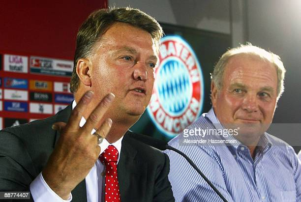 Head coach Louis van Gaal talks to the media whilst Uli Hoeness manager of Bayern Muenchen looks on during a press conference after the FC Bayern...