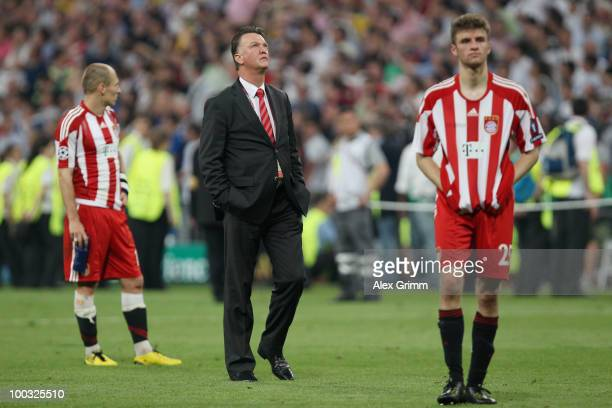 Head coach Louis van Gaal , Thomas Mueller and Arjen Robben of Bayern Muenchen look dejected after their defeat at the end of the UEFA Champions...