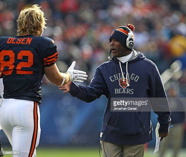 Head coach Lovie Smith of the Chicago Bears congratulates Greg Olsen after Olsen's touchdown catch against the Minnesota Vikings at Soldier Field on...