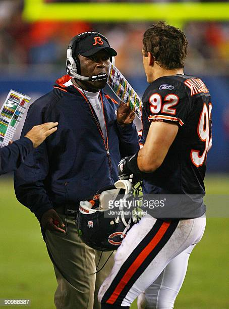 Head coach Lovie Smith of the Chicago Bears gives instructions to Hunter Hillenmeyer during a game against the Pittsburgh Steelers on September 20...