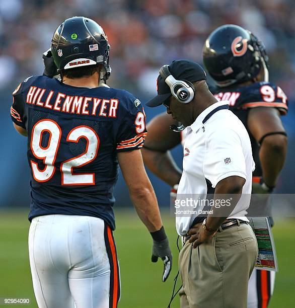 Head coach Lovie Smith of the Chicago Bears reacts as his defensive players including Marcus Harrison and Hunter Hillenmeyer leave the field late in...