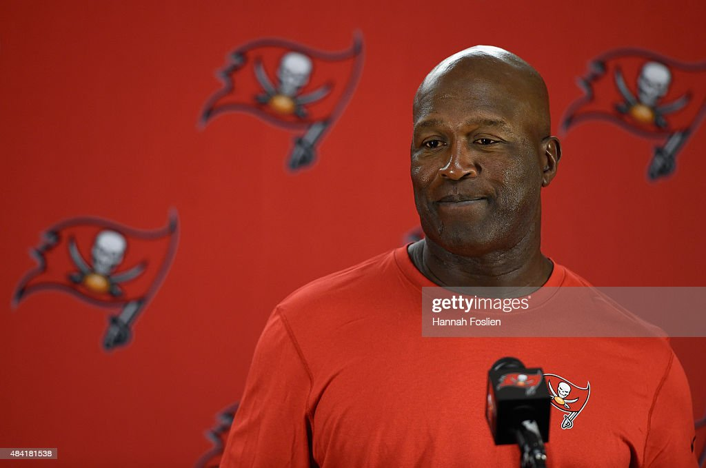 Head coach Lovie Smith of the Tampa Bay Buccaneers speaks to the media after the preseason game against the Minnesota Vikings on August 15, 2015 at TCF Bank Stadium in Minneapolis, Minnesota. The Vikings defeated the Buccaneers 26-16.