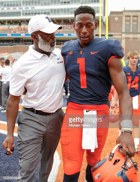 Head coach Lovie Smith talks with quarterback AJ Bush of the Illinois Fighting Illini after the game against the Kent State Golden Flashes at...