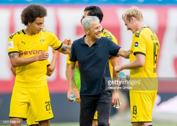 Head coach Lucien Favre and Julian Brandt of Borussia Dortmund are celebrating the win after the final whistle during the Bundesliga match between RB...