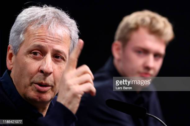 Head coach Lucien Favre gestures next to Julian Brandt during a Borussia Dortmund press conference at Signal Iduna Park on November 04 2019 in...
