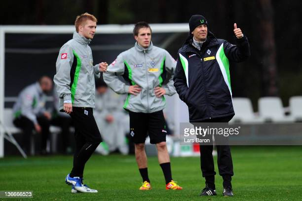 Head coach Lucien Favre gestures next to Marco Reus and Patrick Herrmann during a training session at day six of Borussia Moenchengladbach training...